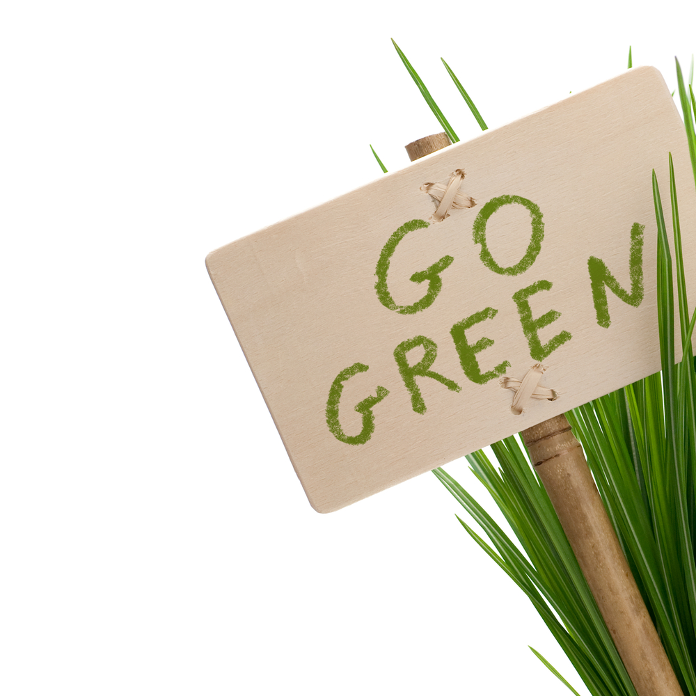 Go Green Sign In Grass On White Background