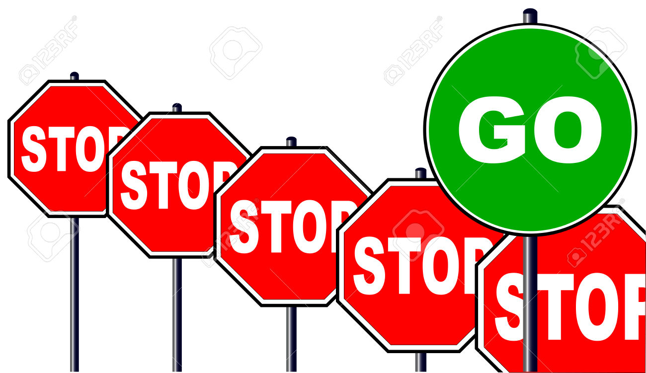 Severa Octagonal Stop Signs And One Large Green Go Sign Isolated