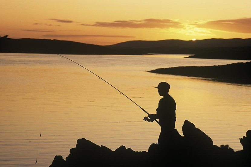 Silhouette Of A Fisherman Fishing Onthe Irish Image Collection