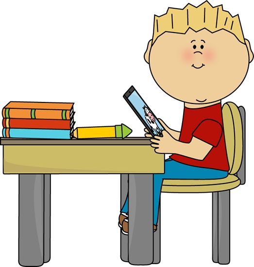 Boy Sitting At School Desk With A Tablet Boy Sitting At
